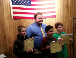 Chancellor Matt Herrick with 5th Grade Spelling Bee Place Winners Ethan Cruickshank (1st), Joel Hueso (3rd), and Locke Bloomquist (2nd) on January 14, 2016.