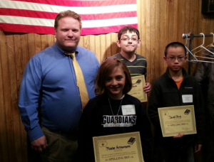 Chancellor Matt Herrick with 6th Grade Spelling Bee Place Winners Phoebe Hermanson (1st), Dylano Castellanos (2nd), and Derek Peng (3rd) on January 14, 2016.