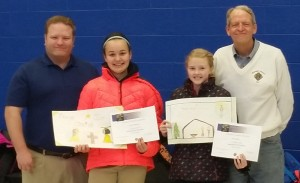 "Winners of the Knights of Columbus ""Keep Christ in Christmas"" poster contest, Dec 18, 2015. Left to right are Jadyn Palmer, Dr. Matt Herrick, and Cassidy Wedemeyer. Special thanks to art teacher Betty Kadner whose efforts made this project happen."
